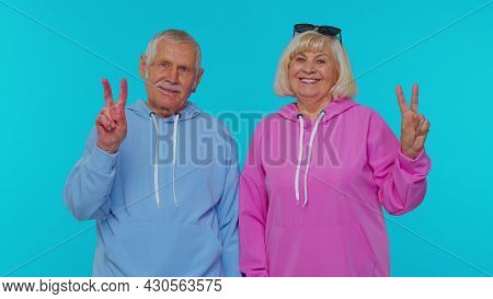 Senior Retired Grandfather Grandmother Showing Victory Sign, Hoping For Success And Win, Doing Peace