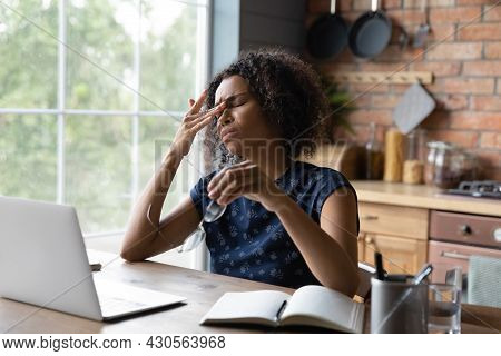 Frustrated African American Remote Employee Tired Of Work At Computer