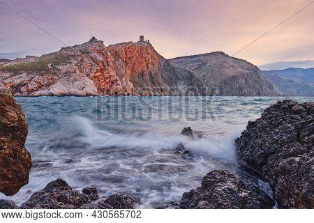 Storm In A Sea Bay During A Wonderful Dawn: Black Sea, Mountain, Rocks, Waves.