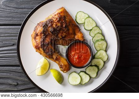 Ayam Bakar Indonesian Grilled Chicken Closeup In The Plate On The Table. Horizontal Top View From Ab