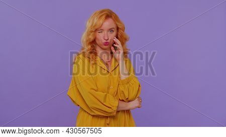 Smiling Playful Happy Stylish Redhead Girl In Dress Blinking Eye, Looking At Camera With Toothy Smil