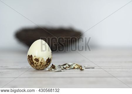 Peeled Hard Boiled Quail Egg With Broken Shell. Selective Focus Points. Blurred Background