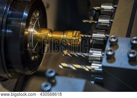 The  Cnc Lathe Machine Swiss Type Thread Tapping The Brass Shaft Parts. The Hi-technology Metal Work