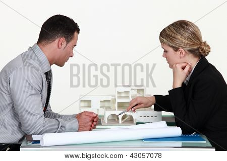 Architects evaluating a building model