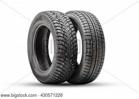 Winter Tires Wheels Are New Isolate. Friction Velcro Wheel And Studded Tire Next To Two Pieces