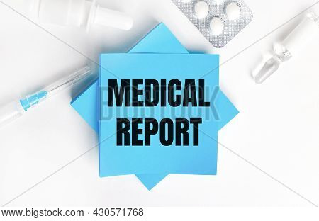 On A White Background, A Syringe, Ampoule, Pills, A Vial Of Medicine And Light Blue Stickers With Th