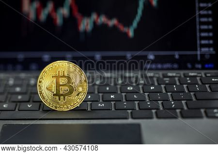 Bitcoin On Computer With Graph On Background, Bit Coin Cryptocurrency Banking Money Transfer Busines