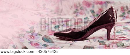 Brown Women High Heel Shoe With Pearl Neglect On  Pink Flower Fabric Banner Background
