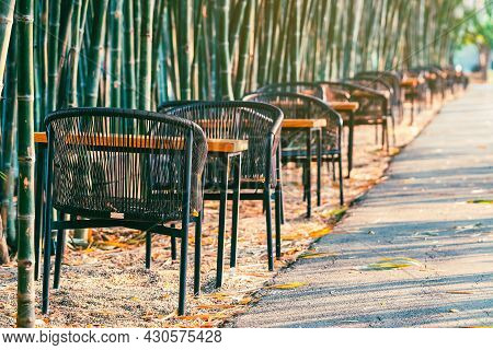 Many Chairs And Tables To Sit And Relax Beside The Path In Natural Green Bamboo Garden. Relaxation V