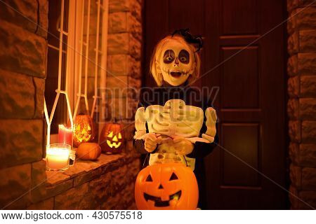 Little Child In Scary Skeleton Costume At Halloween Celebration Party. Baby Is Ready For Trick Or Tr