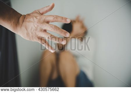 Man Beating Up His Wife
