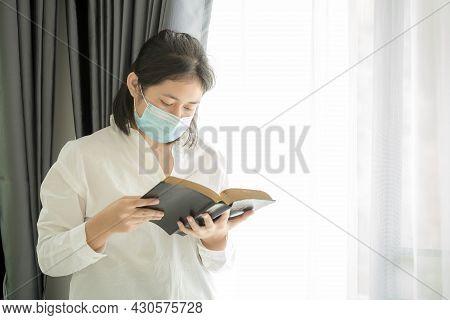Girl Christian Prayer In Medical Face Mask.