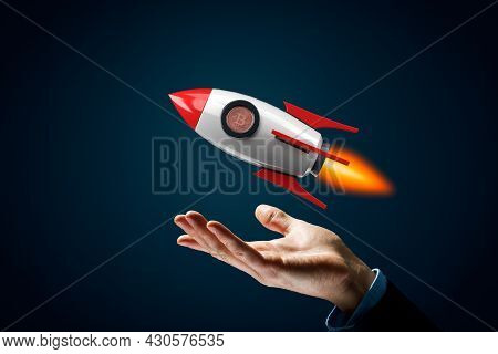 Bitcoin Cryptocurrency Rocket Growth Concept. Model Of Cartoon Rocket Representing Fast Growth And B