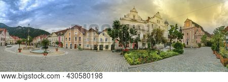 The Main Square With Old Buildings And Parish Church In The Charming Little Town Of Frohnleiten In T