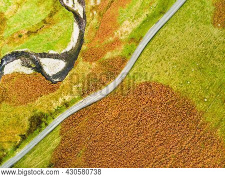 Aerial View Of Honister Pass, A Mountain Pass With A Road Winding Along Gatesgarthdale Beck Mountain