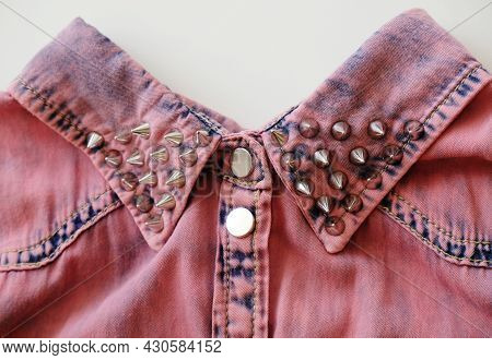 Pink Denim Collar With Metal Studs And Buttons Close Up. White Background