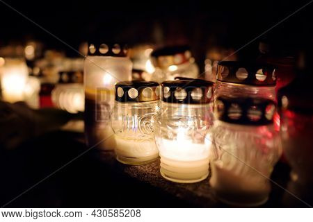 Candles Lit Up On All Souls Day In Lithuania. Candle Flames Illuminating A Cemetery During All Saint