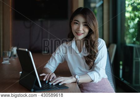 Business Woman Speaking On Video Call On Online Briefing With Laptop Computer At Her Office