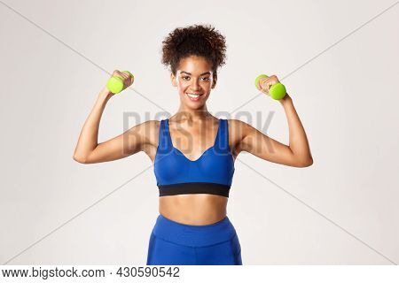Concept Of Sport And Workout. Strong And Fit African-american Fitness Woman In Blue Gym Clothing, Ex