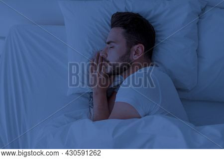Healthy Sleeping, Sleep Hygiene Concept. Young Man Sleeping In Comfy Bed At Home, Copy Space, Top Vi