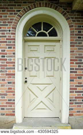 Wooden Door In A Brick Wall At The Crane Estate In Ipswich, Ma