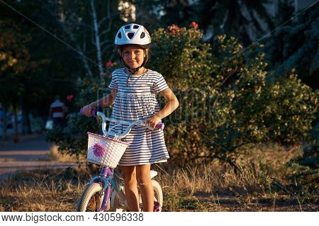 Little Girl With Her Bicycle In The Park. Kid On The Bike