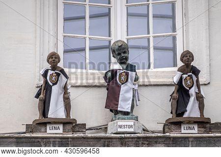 Gent, Flanders, Belgium - July 30, 2021: Nestor, Manneken Pis, Symbol Of Medieval Tanners, And His 2