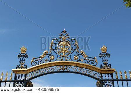 Gate Of The Main Entrance Of The Gardens Of The Source Of The Fountain Of The City Of Nimes