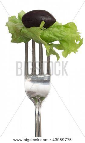 Green salad leaf and olive on the fork, diet concept