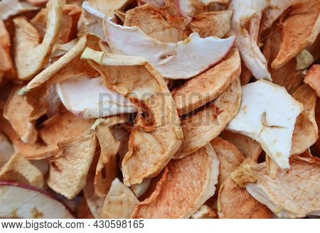 Background Of Slices Of Slices Of Dried Apples Close-up