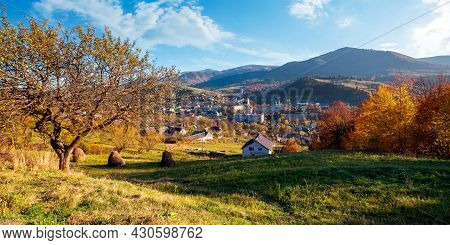 Carpathian Rural Landscape In Autumn. Village In The Valley At The Foot Of The Mountain. Beautiful C