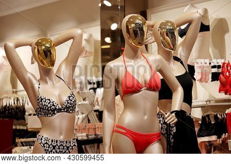 Female Mannequins In Swimwear. Lingerie Store, Bikini, Lace Bra And Panties In A Shop