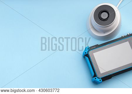 Tools For Installing Video Surveillance. Security Camera And Cctv Tester Monitor On A Blue Backgroun