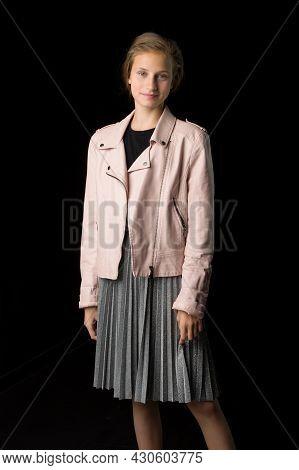 Stylish Girl Posing Against Black Background. Beautiful Teenage Girl Dressed Fashionable Leather Jac