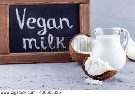 Lactose Free Milk And Chalk Board, Coconut Milk In Powder And Dissolved With Water In Glass Jar, Lac