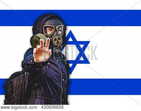 A Girl In A Black Gas Mask And Dark Clothes Against The Background Of The Flag Of Israel, A State Th