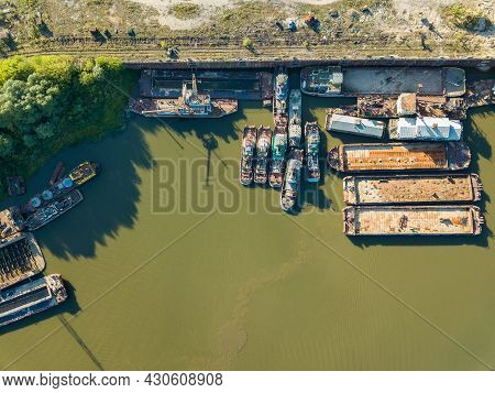 Aerial Drone View, Old Ships And Barges Are On The River On The Pier.