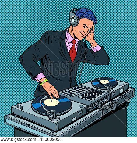 Male Businessman Dj On Vinyl Turntables. Concert Music Performance