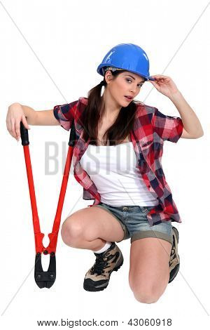 Tired tradeswoman holding clippers