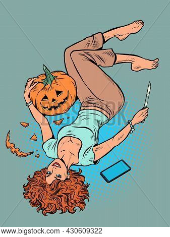 A Beautiful Woman Carves A Halloween Pumpkin. The Girl Is Lying On The Floor With A Knife And A Smar