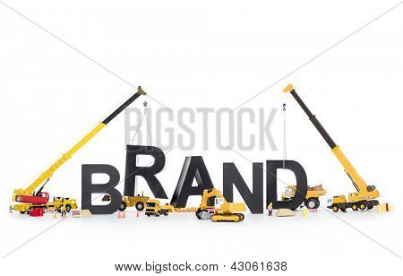 Building up a brand concept: Black alphabetic letters forming the word brand being set up by group of construction machines, isolated on white background.
