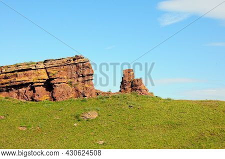 Remains Of An Ancient Stone Structure At The Top Of A Hill.