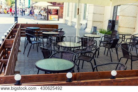 Outdoor Street Cafeor Bar With Tables Ready For Service