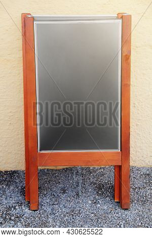 Advertising Wooden Blank Board For The Menu On The Street. Mockup For White Text On A Black Backgrou