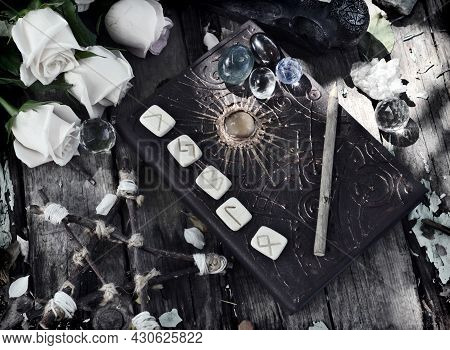 Grunge Still Life With Runes, Magic Book Of Spells, Pentagram And Roses On Witch Table. Esoteric, Go