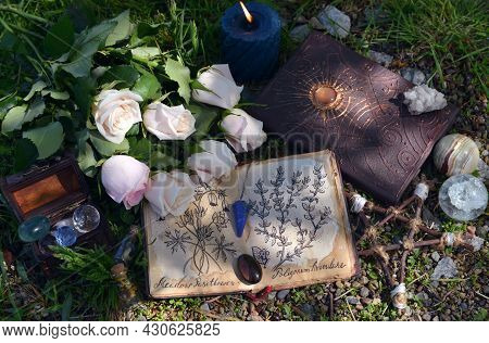 Still Life With Diary With Botanical Drawings On Pages, Crystals And Pentagram On The Grass.  Esoter