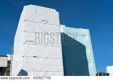Mufti-story Building In Shrink-wrap To Protect Workers Inside And Public On Outside From Risks Assoc