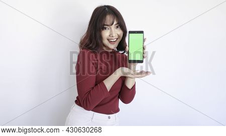 Shock Asian Beautiful Girl Point On Green Screen Phone In White Background