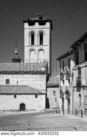 Old street and Santos Justo and Pastor's church in Segovia, Spain. Black and white photography