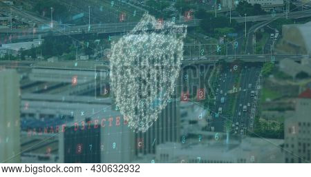 Image of digital interface with online digital padlock and cyber attack warning text over cityscape. Global network online security concept digital composite.